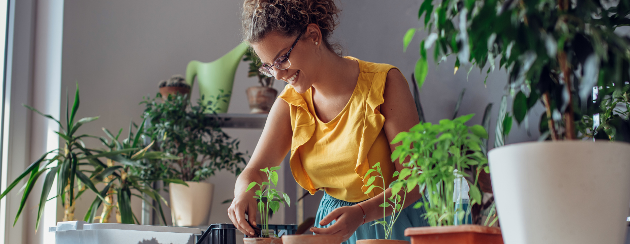 Woman tending to her plants
